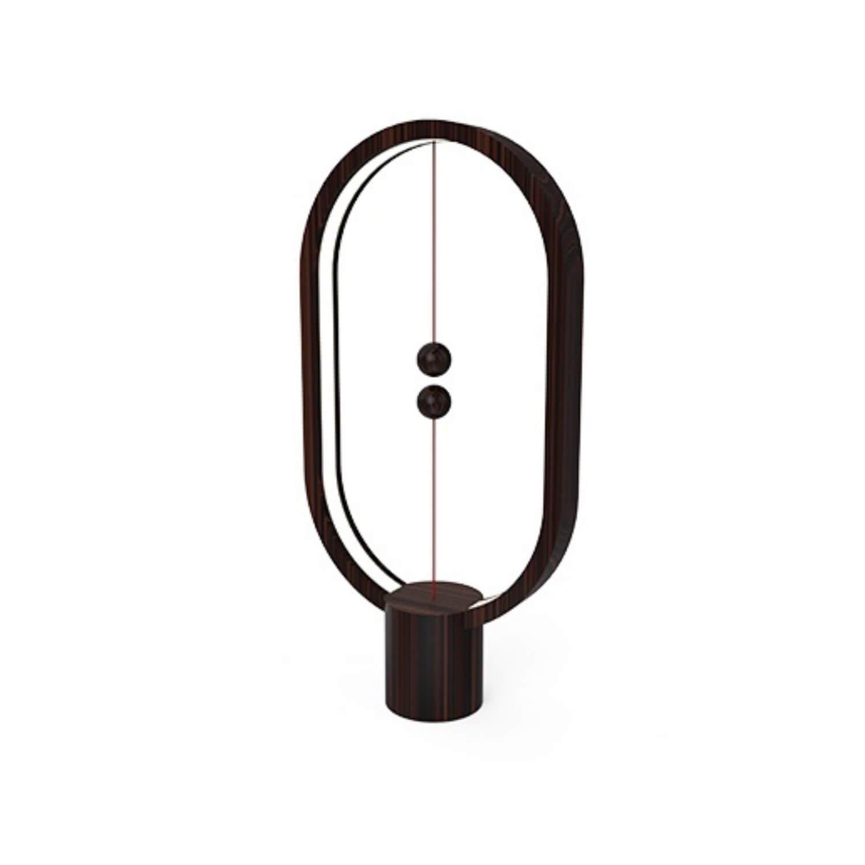 Tischleuchte Heng Balance elliptisch aus dunklem Holz